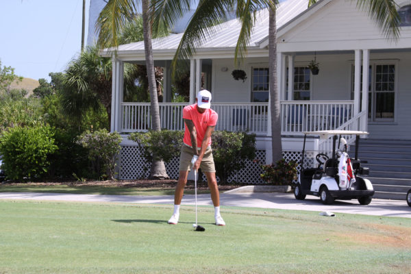 Key West Golf Course person lining up with driver