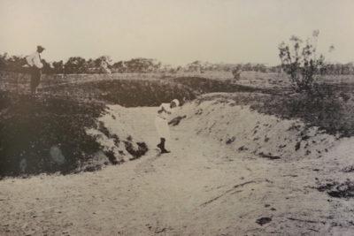 Historical Key West Golf Club player in sand